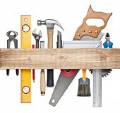 Carpentry, construction hardware tools underneath the wood plank.