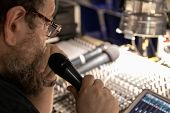 Sound Engineer Behind The Sound Mixing Console Controls The Sound. Digital And Analog Sound Mixer. T poster