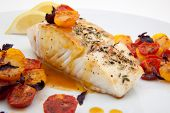 picture of halibut  - Pan fried halibut garnished with fennel seeds and spicy mustard sauce served with fried cherry tomatoes salad with purple basil - JPG