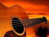 foto of acoustic guitar  - the bridge of an acoustic guitar points off into the sunset - JPG