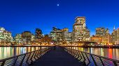 stock photo of highrises  - San Francisco view from Pier 14 at night - JPG