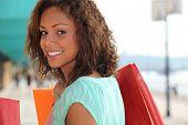 Woman enjoying lavish shopping trip