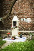 stock photo of polonia  - small shrine against crick wall in Warsaw Poland - JPG