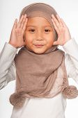 image of malay  - A Malay little girl wearing head scarf as an islamic attire - JPG