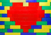 Plastic Brick Heart On The Wall
