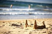 A sandcastle by the ocean