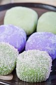 picture of ube  - mochi or sticky rice balls filled with variety of flavors