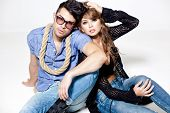 pic of denim wear  - Sexy man and woman doing a fashion photo shoot in a professional studio - JPG