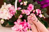 stock photo of threesome  - concept of a valentine threesome with a flower background - JPG