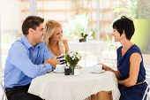 picture of laws-of-attraction  - young woman with boyfriend meeting future mother in law in cafe - JPG