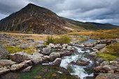 Landscape Over Waterfall Towards Pen-yr-ole-wen Mountain In Snowdonia
