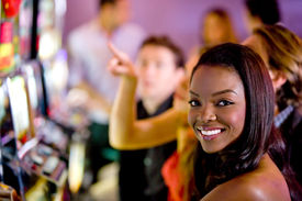 pic of slot-machine  - beautiful woman in a casino at the slot machines - JPG