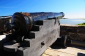 Old Canon Sitting On Top A Fort
