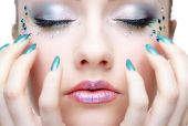picture of nail-art  - portrait of beautiful girl with strasses on the face - JPG