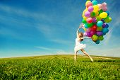 foto of balloon  - Happy birthday woman against the sky with rainbow - JPG