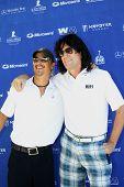 MOOREPARK, CA - SEPT 16:  Tommy Thayer and Brett Scallions arrive at the 6th Annual Scott Medlock & Robby Krieger Golf Invitational & All-Star Concert on September 16, 2013 in Moorepark CA.