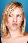 funny face portrait of woman on blue background