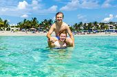 Teen Have Fun Playing Piggyback In The Ocean