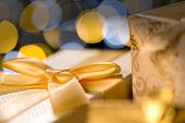 Christmas Gifts wrapped in golden paper and ribbon