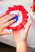 Close up of paper flower making for Bastille day celebration