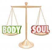 The words Body and Soul weighed on a scale in perfect balance to illustrate the goal of complete hea