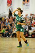 SIOFOK, HUNGARY - SEPTEMBER 14: Aniko Kovacsics in action at a Hungarian National Championship handball match Siofok KC (black) vs. Gyori Audi ETO KC (green), September 14, 2013 in Siofok, Hungary.
