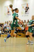 SIOFOK, HUNGARY - SEPTEMBER 14: Katarina Bulatovic (with ball) in action at a Hungarian Championship handball match Siofok KC (black) vs. Gyori ETO KC (green), September 14, 2013 in Siofok, Hungary.