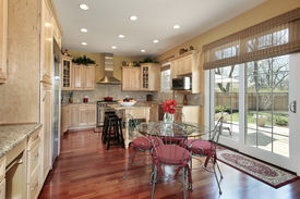 foto of light fixture  - Wood cabinet kitchen with eating area and windows - JPG