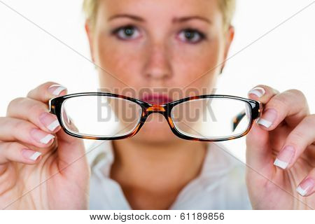 a woman holding glasses in