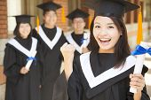 Young College Graduate Holding Diploma  And Make A Fist