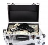 Cases with money and guns, isolated on white