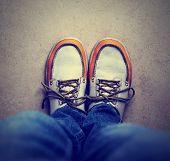 a shot of yellow and white boat or deck shoes done with a retro vintage instagram filter