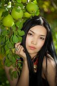 Beautiful girl in the garden with Pears