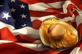 Baseball in glove on American flag
