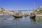 The iconic Rabelo Boats, the traditional Port Wine transports, with the Ribeira District and the Dom
