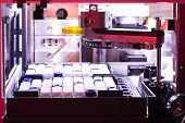 foto of hplc  - HPLC autosampler in a real laboratory lit with red gel vials in rack - JPG