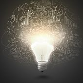 stock photo of lightbulb  - Conceptual image of electric bulb against grey background - JPG