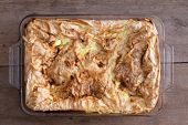 pic of phyllo dough  - Freshly baked Turkish borek a traditional flaky phyllo or yufka pastry often filled with a savory filling such a cheese vegetables or meat in a glass oven dish close up on a rustic wooden boards - JPG
