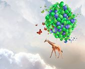 Giraffe flying high in sky on bunch of colorful balloons