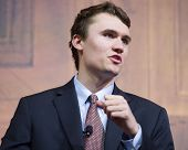 NATIONAL HARBOR, MD - MARCH 7, 2014: Charlie Kirk, Executive Director of Turning Point USA, speaks a