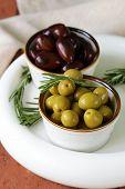 marinated green and black olives (Kalamata) in a ceramic bowl