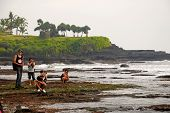 Tourists Photograph The Temple Tanah Lot