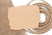 Old paper for copy space over rope with burlap