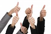 Sucess concept with hands making thumbs up over a white background