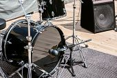 image of drum-kit  - Black drum kit with powerful speaker in background - JPG