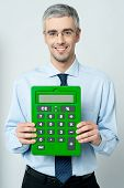 Corporate Man Showing Calculator