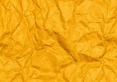 Crumpled Yellow Paper Texture Background. Craft Paper Sheet, Vivid Color. Texture Of Crumpled Paper.