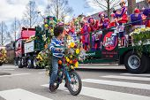 Lisse, Netherlands - April 20, 2013: Boy on bicycle on flower parade. The annual Flower Parade in Ho