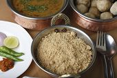 picture of rajasthani  - Churma is coarsely ground wheat crushed and cooked with ghee and sugar - JPG