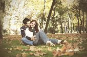 Love and affection between a young couple at the park in autumn season